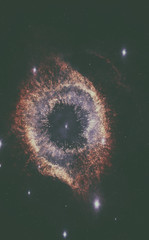 Helix Nebula is a large planetary nebula located in the constellation Aquarius. Elements of this image are furnished by NASA