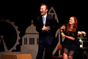 Member of the cast Paul Rich performs as David Cameron with Sarah Covey as Samantha Cameron in 'Brexit-The Musical' at the Edinburgh Fringe, in Edinburgh