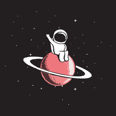 Baby astronaut sits on Saturn