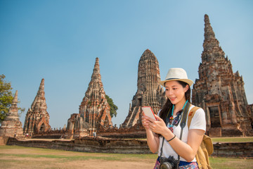 Asian woman using smartphone looking map