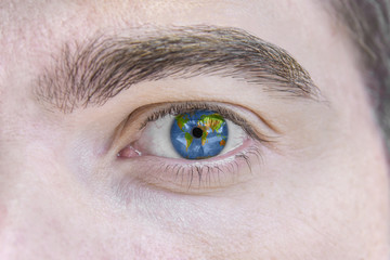 Human eye painted with world space geography map
