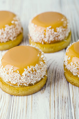 yellow cakes on wood surface