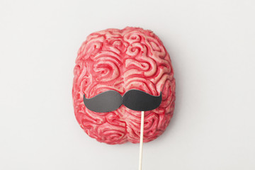 Human brain with comedy props
