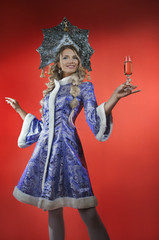 Beautiful snow maiden with a glass of champagne