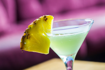 Coctail with pineapple in martini glass
