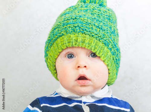 3f896e66517 portret funny baby boy in a warm green hat