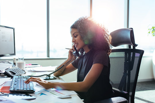 Businesswoman working at her desk in office.