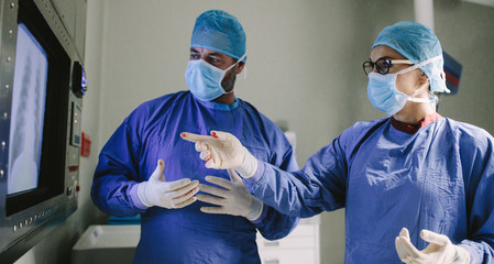 Team of surgeons using new technology on surgery