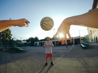 Point of view image of man throwing basketball at teammate