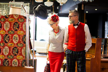 Quirky vintage couple shopping in antiques and vintage emporium