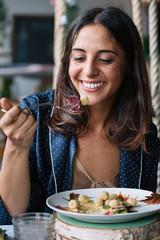 Woman enjoying vegetarian dish
