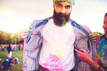 Portrait of young male hipster with chalk handprints on tshirt at festival