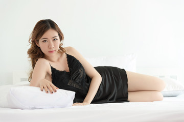 Sexy asian slim woman posing in bed