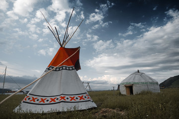 Teepee and yurt set on the meadow