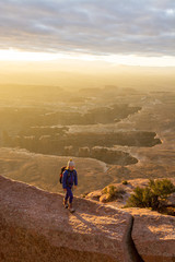 Young girl walking on rocks while hiking in Canyonlands National Park