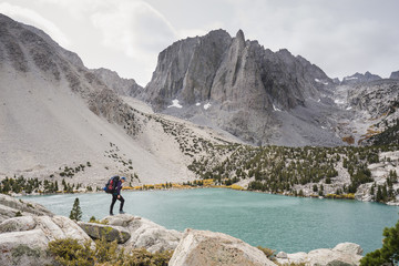Side view of female hiker standing by Second Lake
