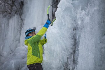 Side view of man climbing on ice