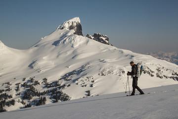 Man snowshoeing in Garibaldi Provincial Park near Black Tusk mountain