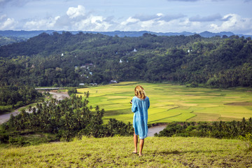 Woman at mountains, Sumba, Indonesia