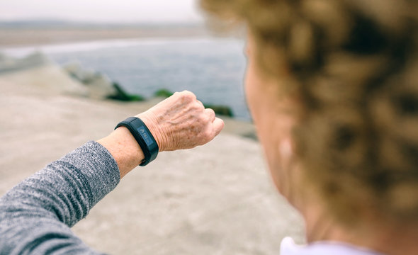 Unrecognizable senior woman looking smart watch