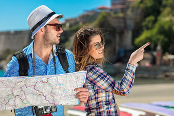 Couple tourist traveling and using map. Couple tourist exploring a city.