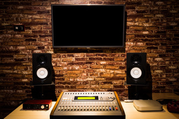 digital sound mixer, monitor speakers & LED screen in recording studio. music production
