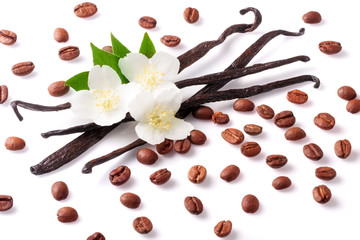 Vanilla sticks and coffee beans with flower isolated on white background