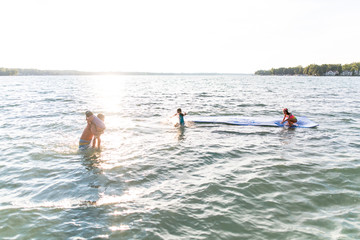 Small group of people playing in lake
