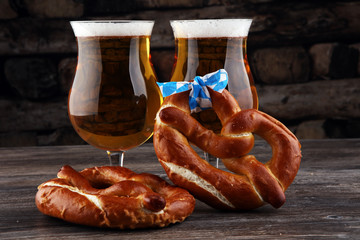 Original bavarian pretzels with beer on wooden board. Oktoberfest background