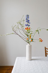 Interior of a house in The Netherlands in 2016. Colourful hip flowers in a simple and elegant vase.
