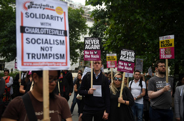 Demonstrators hold placards during an anti-fascist protest outside the U.S Embassy in London