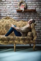 Young woman sleeping on baroque sofa