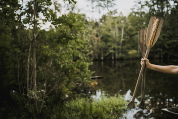 Hand holding oars