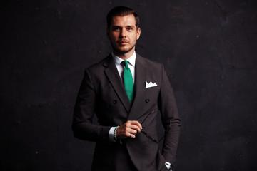 Elegant young handsome man. Studio fashion portrait