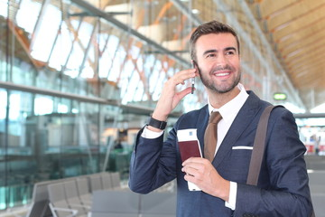 Satisfied first class traveler calling by phone with space for copy