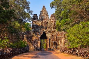 Entrance to ancient Angkor Wat temple at sunrise