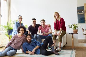 Portrait Of Confident Designers In Creative Office