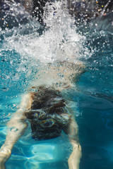 Woman swimming in pool.