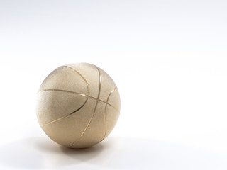 Gold metalic Basketball close-up on bright studio background