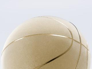 Gold metalic Basketball close-up on bright studio background