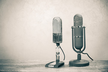 Old retro big ribbon microphones from 50s on table. Vintage style sepia photo