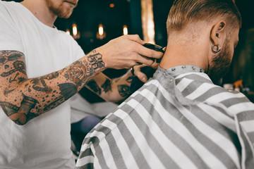 Neck trimming in barber shop.