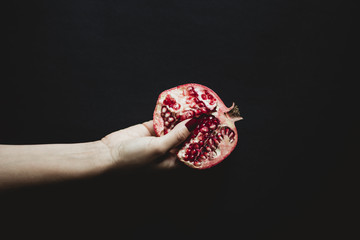 Hand and pomegranate