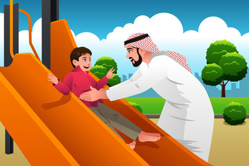 Muslim Arabian Man with His Child in the Playground