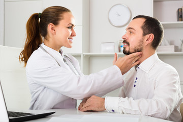 Male patient visiting consultation with woman doctor