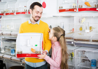 Girl with her father pleased the selected purchase