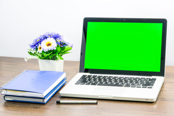 Laptop blank screen for text or pictures on wooden table. Concept for advertising, business and home office.