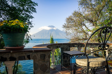 Very special view of Volcano San Pedro from a charming terrace on the shore of Lake Atitlan in Guatemala.