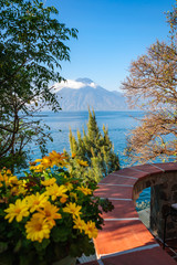 Picturesque View of  Volcano San Pedro with a crown of clouds from the round terrace on the shore of Lake Atitlan in Guatemala.
