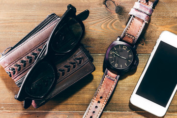 Leather wallet and watch on wooden background - Man accessories
